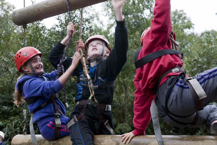 Young adventurers working as a team