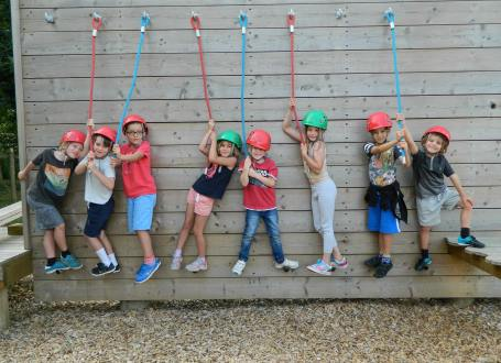 Children enjoying the challenge course at one of our summer camps in Surrey